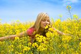 smelling yellow flowers