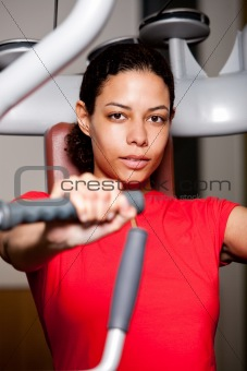 Beautiful girl working out at the gym