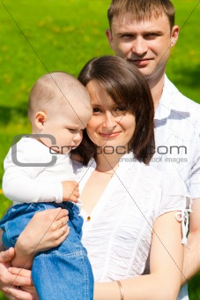 Baby with parents in park