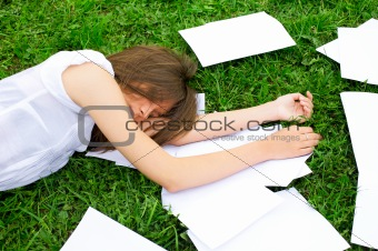 Business woman lying on the grass