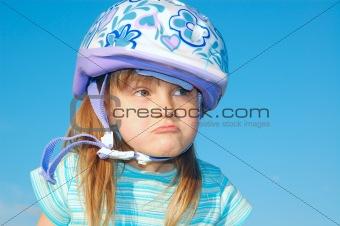 grimacing girl with a helmet