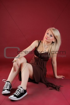 smiling blonde sitting on a floor