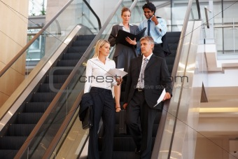 Sophisticated business people on escalator