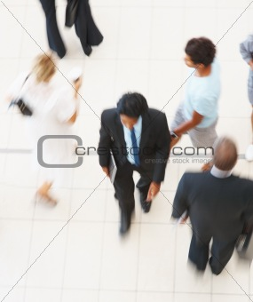 Top view of business people walking in lobby