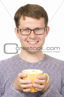 A smiling man with a yellow cup