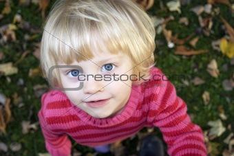 Little girl looks with big eyes