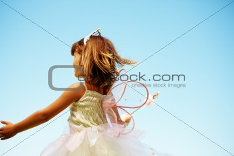 Little girl wearing fairy wings
