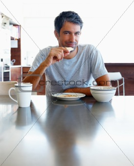 Mature man having breakfast at dinning table