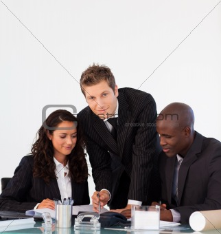 Business people discussing in an office and looking at the camer