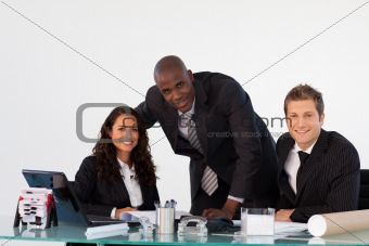 Business team in an office smiling at the camera