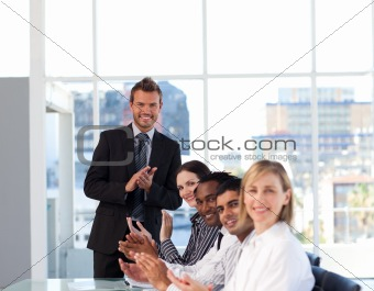 Business people clapping after a presentation