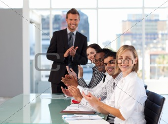 Businessteam clapping at the end of a presentation