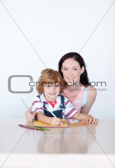 Mother and son drawing with copyspace