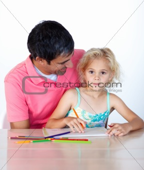 Little girl painting with her father