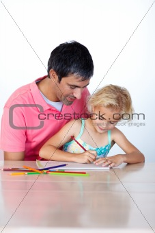 Beautiful daughter painting with her father