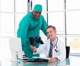 Senior doctor and young surgeon studying an X-ray