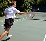 Tennis Player smashing a ball