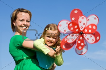 Little girl and woman playing outdoors