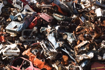 old rusting cars in a junk yard