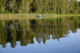 Fisherman on the calm lake