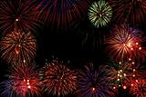 Composition of colorful fireworks over black background