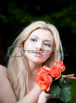 Beauty Blonde Woman With Roses