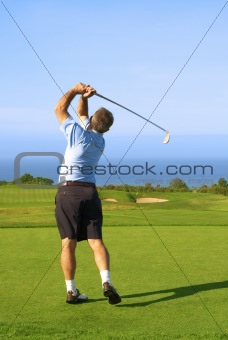 Senior golfer playing golf