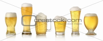 Different glasses of lager beer
