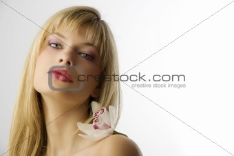 blond girl with orchid