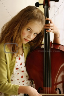 Close-up portrait of a pretty young girl with a cello.