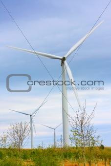 Modern windmills against blue sky