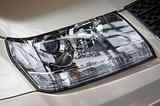 headlight on a beige car