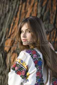 portrait of beautiful girl near the tree