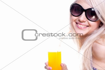 beautiful women in swimsuit with a glass of juice