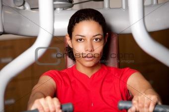 Beautiful girl on fitness machine