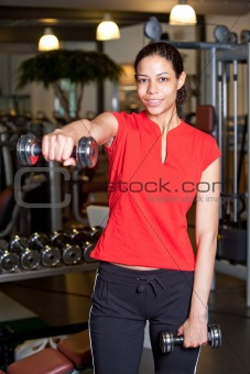 Attractive young woman doing fitness
