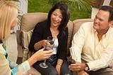 Three Friends Enjoying Wine on an Outdoor Patio.