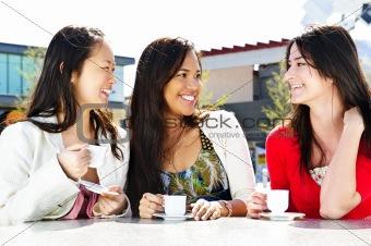 Group of girlfriends having coffee