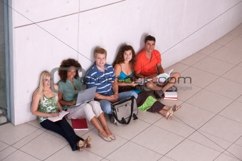 Group of happy students studying