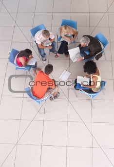 Group of students sitting down with lecturer