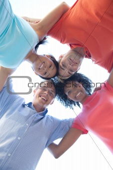 group of happy friends huddling