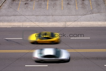 Cars Pass In Blurred Motion