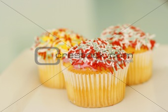 Brightly colored cupcakes.