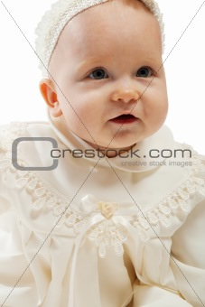 Baby in baptismal dress