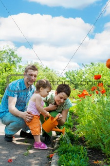 Family watering flowers