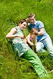 Family lying in grass