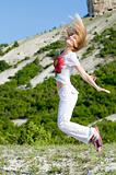 jumping girl in the mountains