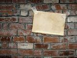 Sheets paper, hanging on a brick wall