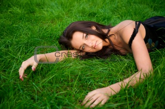 Beautiful women relaxing on green grass