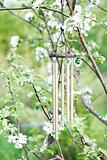 Windchime with floral background.
